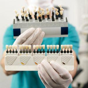 Dentist holding dental veneers